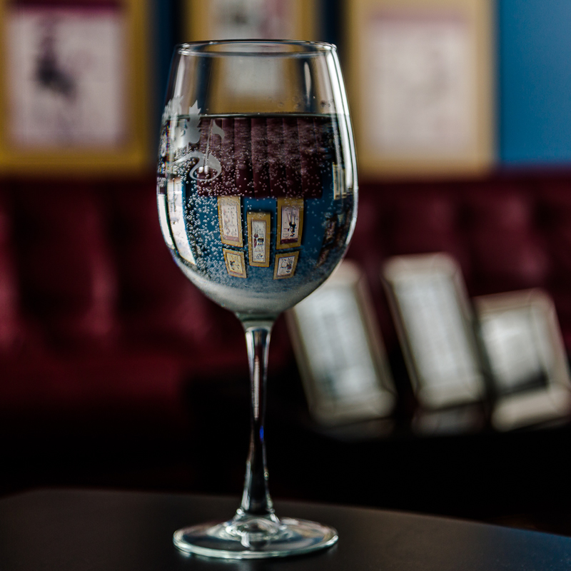 Photos Reflected in Wineglass by Stino